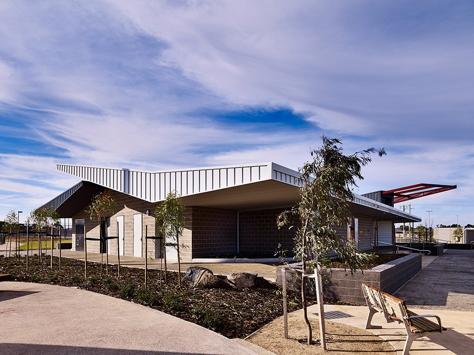 Sports pavilion alongside recreation reserve and oval