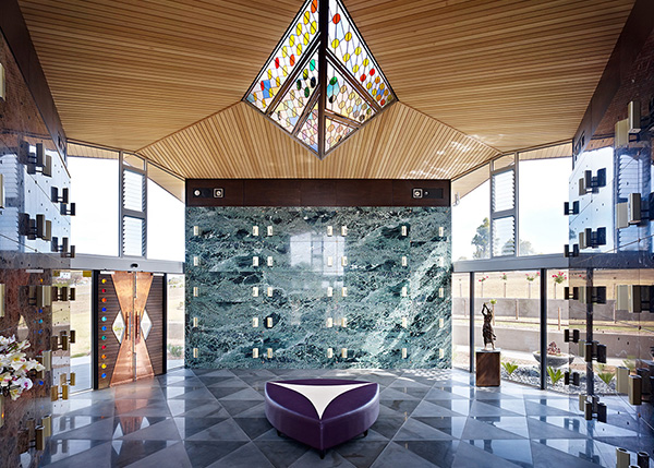 Mausoleum interior with coloured glass skylight, copper doors, bluestone tile floor, copper and hardwood doors,