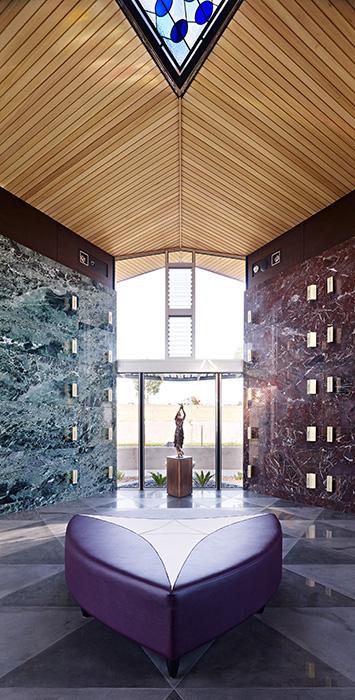 Mausoleum interior with coloured glass skylight, copper doors, bluestone tile floor, copper and hardwood doors,