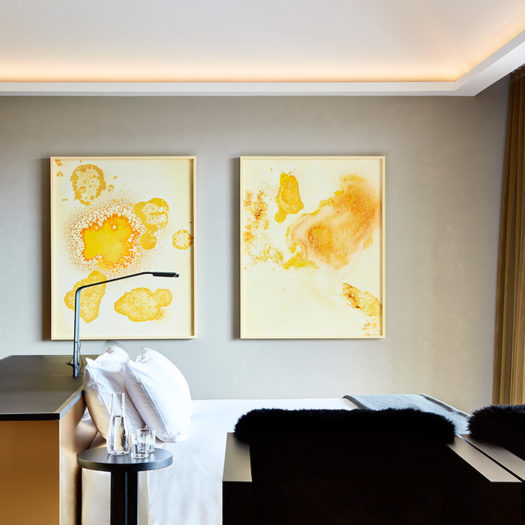 Hotel room with bright yellow artwork - example of hotel/ restaurant photography by Rhiannon Slatter