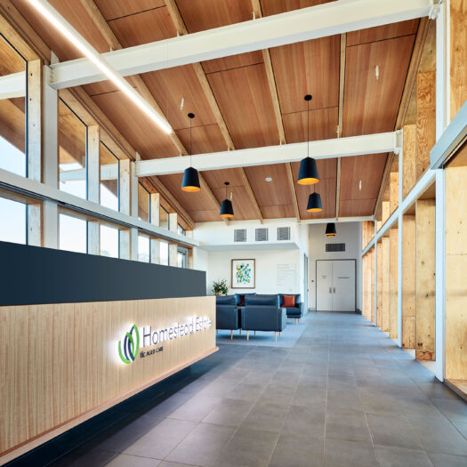 TLC Aged Care Homestead Estate main reception desk with signage and timber throughout - building photographer example / concept