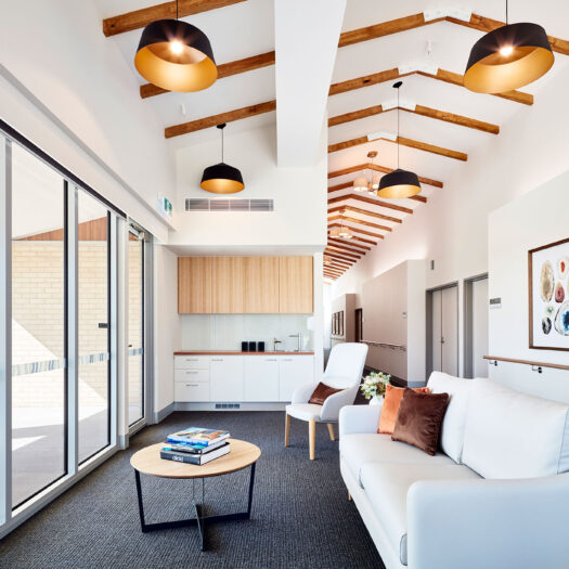 TLC Aged Care Homestead Estate lounge room with tea station, couch, armchair and coffee table - building photographer example / concept