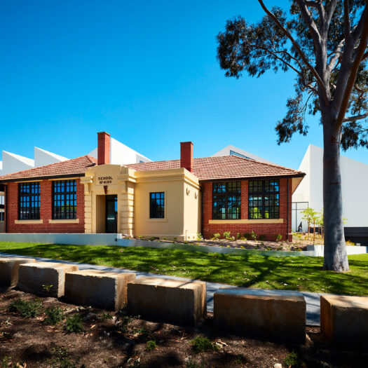 Nunawading Community Hub brick state school facade with sawtooth roofline behind - structure photographer example / concept