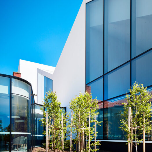 Nunawading Community Hub curved glass link between old and new sections of building - structure photographer example / concept