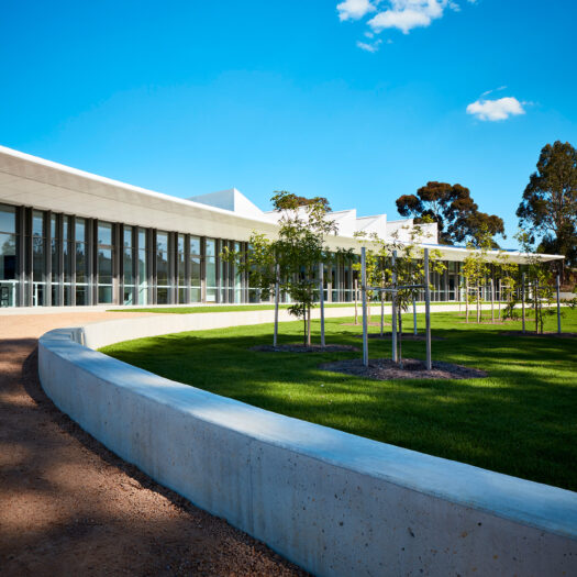 Nunawading Community Hub curved concrete garden edge with glass building facade behind - structure photographer example / concept COMMUNITY HUB 5