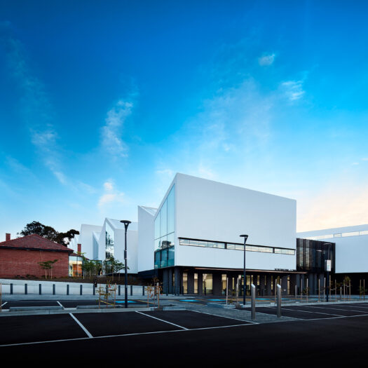 Nunawading Community Hub view across old and new sections of building across carpark - structure photographer example / concept
