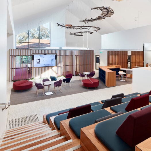 Nunawading Community Hub reception and administration area with stairs and tireed seating and various types of communal seating - structure photographer example / concept