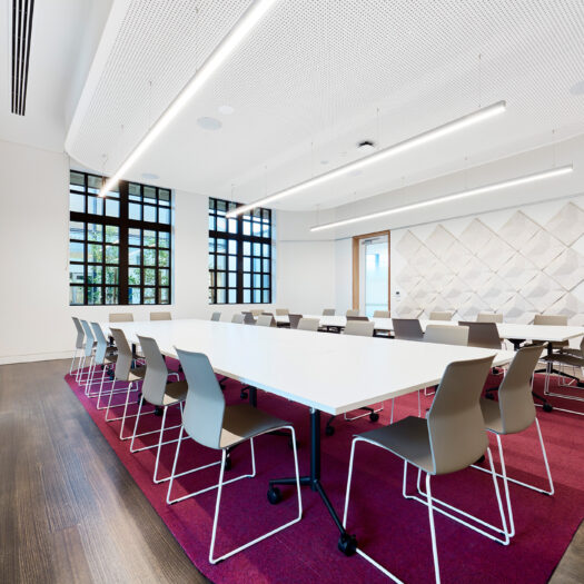 Nunawading Community Hub meeting space with strip lights, acoustic wall panels and timber floor with magenta carpet through middle - structure photographer example / concept