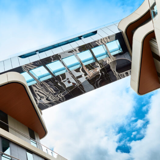 Hawthorn Park sky bridge linking two buildings with pool - building photographer example / concept