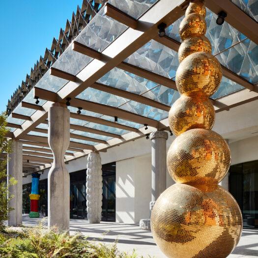 Monash University Chancellery featuring brilliant golden sculpture reflecting sunlight - University example / concept