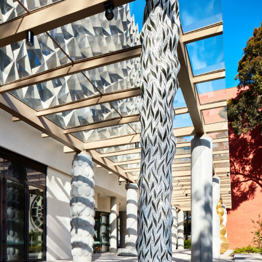 Monash University Chancellery black and white artist column and late afternoon shadow play - University example / concept