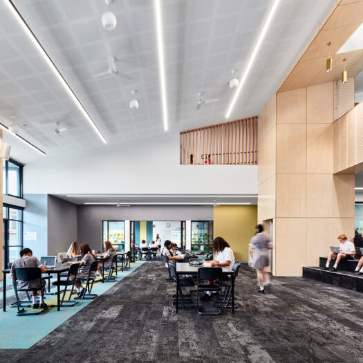 Ringwood Secondary College open plan learning space, students studying with window seat and stair - High School photography example / concept