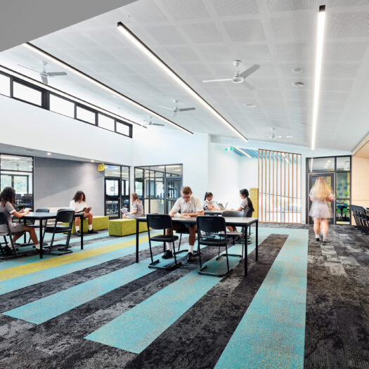 Ringwood Secondary College blue linear carpet, timber bench, highlight window, view into classrooms and open study space - High School photography example / concept