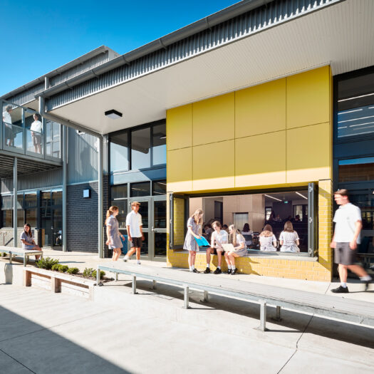 Ringwood Secondary College yellow window seat with senior students moving around and working together - High School photography example / concept