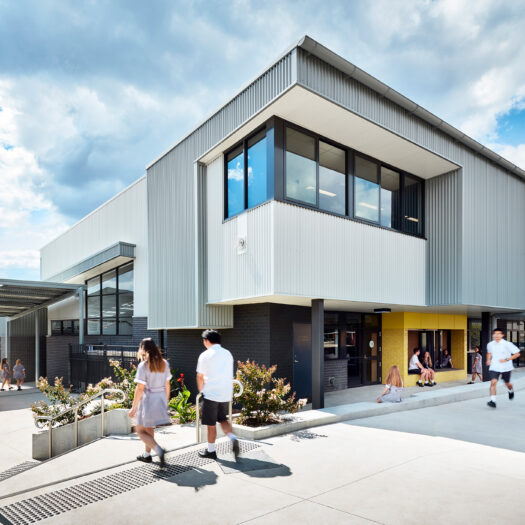 Ringwood Secondary College students moving around outside senior learning centre - High School photography example / concept