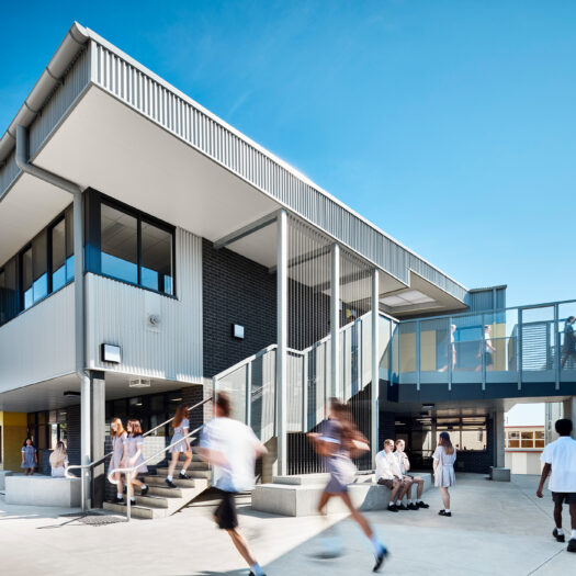 Ringwood Secondary College external staircase on senior learning centre with bridge connecting to next building and students circulating - High School photography example / concept