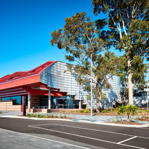 Springvale Library and Community Hub building curving around tree - structure photographer example / concept