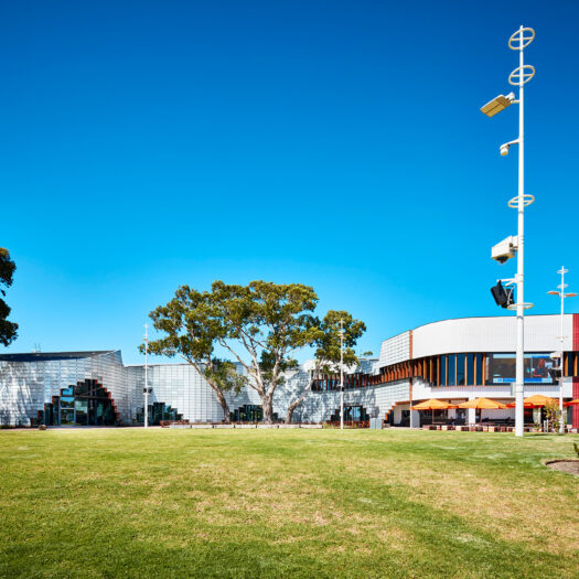 Springvale Library and Community Hub sloping lawn towards building with arched entries - structure photographer example / concept