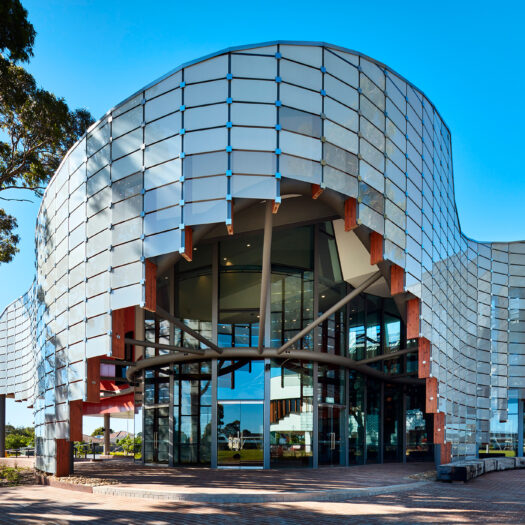 Springvale Library and Community Hub glass front with sweeping curves - structure photographer example / concept