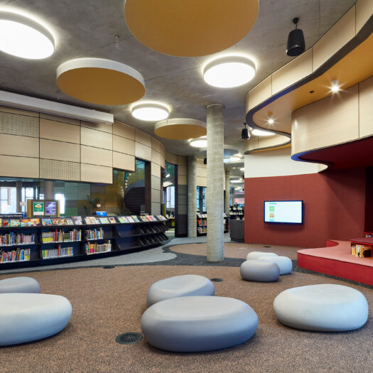 Springvale Library and Community Hub children's area with pebble seats and round ceiling lights - structure photographer example / concept